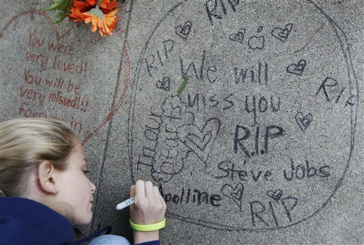 "<div class=""meta image-caption""><div class=""origin-logo origin-image ""><span></span></div><span class=""caption-text"">Apolline Arnaud, 12, a neighbor of Steve Jobs, writes a message in front of Jobs' home in Palo Alto, Calif., Wednesday, Oct. 5, 2011. Jobs, the Apple founder and former CEO who invented and masterfully marketed ever-sleeker gadgets that transformed everyday technology, from the personal computer to the iPod and iPhone, has died. He was 56. (AP Photo/Paul Sakuma) (AP Photo/ Paul Sakuma)</span></div>"