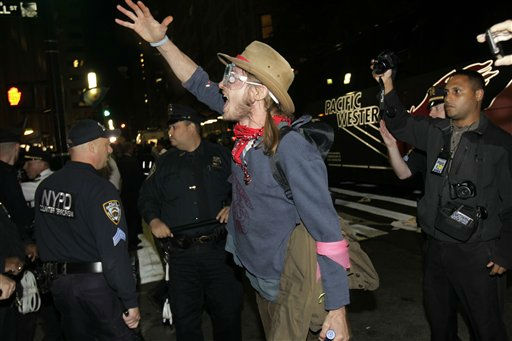 An Occupy Wall Street protester yells at police officers as they make arrests in New York, Wednesday, Oct. 5, 2011.    Protesters in suits and T-shirts with union slogans left work early to march with activists who have been camped out in Zuccotti Park for days. Some marchers brought along their children, hoisting them onto their shoulders as they walked down Broadway.  &#40;AP Photo&#47;Seth Wenig&#41; <span class=meta>(AP Photo&#47; Seth Wenig)</span>
