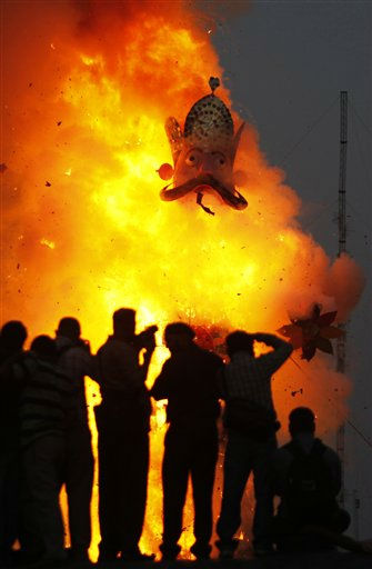 "<div class=""meta ""><span class=""caption-text "">An effigy of demon king Ravana's son Meghnath goes up in flames marking the end of Dussehra festival in Jammu, India, Thursday, Oct. 6, 2011.The festival commemorates the triumph of Hindu god Rama over the demon king Ravana, marking the victory of good over evil. (AP Photo/Channi Anand) (AP Photo/ Channi Anand)</span></div>"