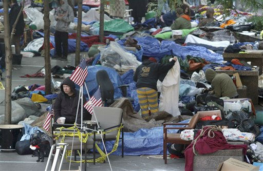 Participants in the  Occupy Wall Street Protest continue their encampment at Zuccotti Park on Thursday, Oct. 6, 2011 in New York.  The protest, which has grown into a nationwide movement, started on Sept. 17 with a few dozen demonstrators who tried to pitch tents in front of the New York Stock Exchange.  &#40;AP Photo&#47;Bebeto Matthews&#41; Jordan McCarthy, 22, from Sandwich, N.H., awake from under a makeshift shelter where she is camped out among participants in the Occupy Wall Street Protest at Zuccotti Park in lower Manhattan on Wednesday, Oct. 5, 2011 in New York.  &#34;We have allowed greed to be more important than humans,&#34; said McCarthy who joined the camp a week ago.     &#40;AP Photo&#47;Bebeto Matthews&#41; <span class=meta>(AP Photo&#47; Bebeto Matthews)</span>
