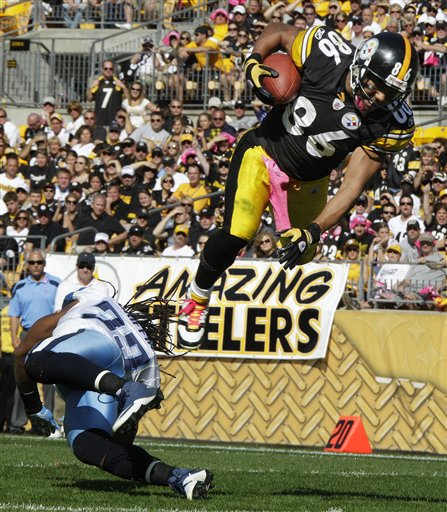 Pittsburgh Steelers receiver Hines Ward &#40;86&#41; heads to the end zone over Tennessee Titans safety Michael Griffin, scoring a touchdown during the third quarter of an NFL football game in Pittsburgh, Sunday, Oct. 9, 2011. &#40;AP Photo&#47;Gene J. Puskar&#41; <span class=meta>(AP Photo&#47; Gene J. Puskar)</span>