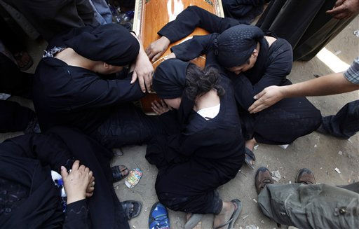 "<div class=""meta ""><span class=""caption-text "">Egyptian relatives of one of the Copts who were killed during clashes with the Egyptian army late Sunday, mourn over his coffin outside the morgue of the Copts' hospital in Cairo, Egypt, Monday, Oct. 10, 2011. Egypt's Coptic church blasted authorities Monday for allowing repeated attacks on Christians with impunity as the death toll from a night of rioting rose to more than two dozen, most of them Christians who were trying to stage a peaceful protest in Cairo over an attack on a church. (AP Photo/Khalil Hamra) (AP Photo/ Khalil Hamra)</span></div>"
