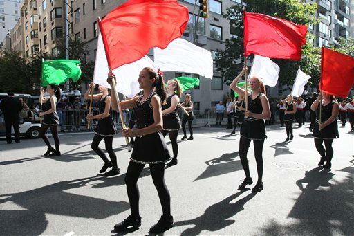 "<div class=""meta image-caption""><div class=""origin-logo origin-image ""><span></span></div><span class=""caption-text"">Members of the Connetquot High School color guard, of Bohemia, New York, perform a flag routine along Fifth Avenue as they take part in the Columbus Day Parade on Monday Oct. 10, 2011, in New York. (AP Photo/Tina Fineberg) (AP Photo/ Tina Fineberg)</span></div>"