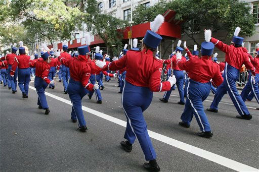 Members of the Stony Brook University Seawolves perform a routine as they make their way up Fifth Avenue during the Columbus Day Parade on Monday, Oct. 10, 2011, in New York. &#40;AP Photo&#47;Tina Fineberg&#41; <span class=meta>(AP Photo&#47; Tina Fineberg)</span>