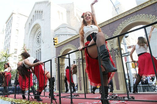 Performers dance on a float headed up Fifth Avenue during the Columbus Day Parade Monday, Oct. 10, 2011, in New York. &#40;AP Photo&#47;Tina Fineberg&#41; <span class=meta>(AP Photo&#47; Tina Fineberg)</span>