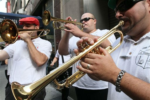 Tommy Russo, left, Anthony Gonzalez, center, and Daniel Vecchiano play a tune as they wait for the start of the Columbus Day Parade Monday, Oct. 10, 2011, in New York. &#40;AP Photo&#47;Tina Fineberg&#41; <span class=meta>(AP Photo&#47; Tina Fineberg)</span>