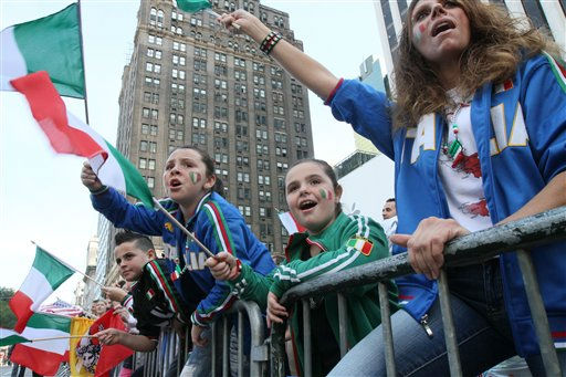 Mary Nunziata, right, her daughters, Giacoma, 9, second from right, and Maria, 7, second from left, and son Pasquale, 9, left, cheer while watching the Columbus Day Parade as it makes its way up Fifth Avenue Monday, Oct. 10, 2011, in New York. &#40;AP Photo&#47;Tina Fineberg&#41; <span class=meta>(AP Photo&#47; Tina Fineberg)</span>