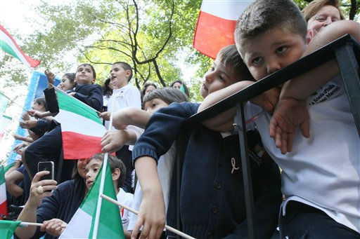 Francesco Contestabile, 6, second from right, leans on Rocco Sebastini, 6, right, as they and others ride up Fifth Avenue on their school, La Scuola D&#39;Italia Guglielmo Marconi&#39;s, float during the Columbus Day Parade on Monday Oct. 10, 2011. in New York. &#40;AP Photo&#47;Tina Fineberg&#41; <span class=meta>(AP Photo&#47; Tina Fineberg)</span>