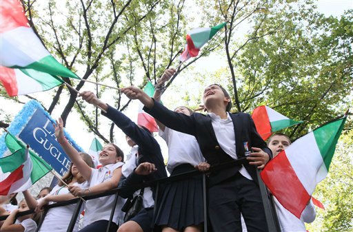 Children wave Italian flags as they ride up Fifth Avenue on their school, La Scuola D&#39;Italia Guglielmo Marconi&#39;s, float during the Columbus Day Parade on Monday Oct. 10, 2011. in New York. &#40;AP Photo&#47;Tina Fineberg&#41; <span class=meta>(AP Photo&#47; Tina Fineberg)</span>