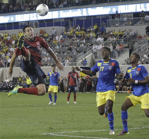 United States midfielder Clint Dempsey goes up for the ball against Ecuador in the second half of an international soccer friendly game, Tuesday, Oct. 11, 2011, in Harrison, N.J. Ecuador&#39;s Jaime Ayovi &#40;17&#41; and Fricson Erazo &#40;3&#41; look on during the play. Ecuador won 1-0. &#40;AP Photo&#47;Julio Cortez&#41; <span class=meta>(AP Photo&#47; Julio Cortez)</span>