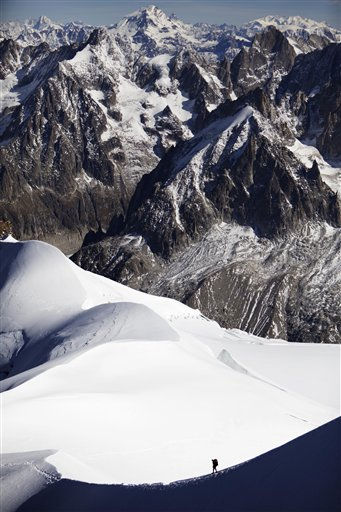 An alpinist walks down a ridge on the Aiguille du Midi &#40;3,842 meters; 12 605 feet&#41;, towards the Vallee Blanche on the Mont Blanc massif, in the Alps, near Chamonix, France, Wednesday, Oct. 12, 2011. &#40;AP Photo&#47;David Azia&#41; <span class=meta>(AP Photo&#47; David Azia)</span>