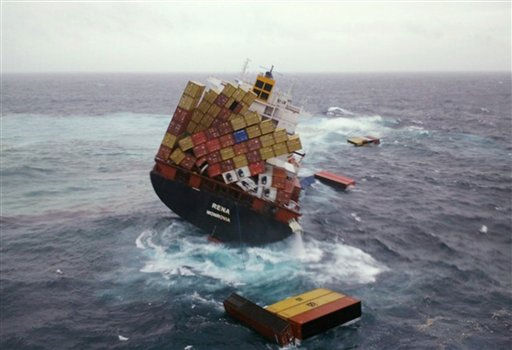 "<div class=""meta ""><span class=""caption-text "">In this photo provided by Maritime New Zealand, shipping containers float Wednesday, Oct. 12, 2011, in the water around the cargo ship Rena that has been foundering since it ran aground Oct. 5 on the Astrolabe Reef, about 14 miles (22 kilometers) from Tauranga Harbour, New Zealand. The condition of the stricken cargo ship stuck that is leaking oil worsened Wednesday, with about 70 containers falling overboard and the vessel moving onto a steeper lean. (AP Photo/Maritime New Zealand, Blair Harkness) (AP Photo/ Blair Harkness)</span></div>"