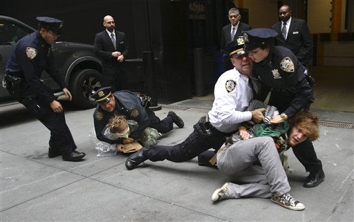 "<div class=""meta image-caption""><div class=""origin-logo origin-image ""><span></span></div><span class=""caption-text"">Police arrest marchers from Zuccotti Park's Occupy Wall Street, during a protest near One Chase Manhattan Plaza on Wednesday, Oct. 12, 2011 in New York. The protest is now in its fourth week. (AP Photo/Bebeto Matthews) (AP Photo/ Bebeto Matthews)</span></div>"