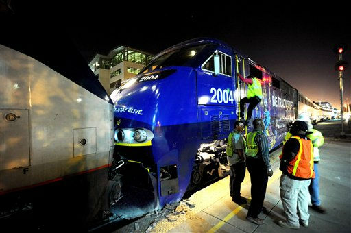 Two Amtrak trains rest against each other after colliding at an Oakland, Calif., station on Wednesday, Oct. 12, 2011. A fire official said one train was unloading passengers when the second train ran into it at an estimated speed of 15 to 20 miles per hour injuring about 16 people. &#40;AP Photo&#47;Noah Berger&#41; <span class=meta>(AP Photo&#47; Noah Berger)</span>