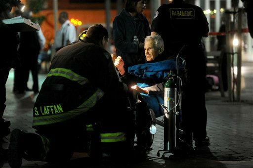 Amtrak passenger James Ferguson, 90, speaks with emergency responders following a collision at an Oakland, Calif., station on Wednesday, Oct. 12, 2011. Ferguson, who lives in Los Angeles and has congestive heart failure, was uninjured. A fire official said one train was unloading passengers when the second train ran into it at an estimated speed of 15 to 20 miles per hour injuring about 16 people. &#40;AP Photo&#47;Noah Berger&#41; <span class=meta>(AP Photo&#47; Noah Berger)</span>