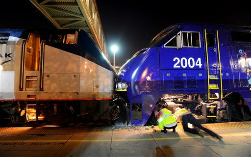 "<div class=""meta ""><span class=""caption-text "">Amtrak workers examine a train collision at an Oakland, Calif., station on Wednesday, Oct. 12, 2011. A fire official said one train was unloading passengers when the second train ran into it at an estimated speed of 15 to 20 miles per hour injuring about 16 people. (AP Photo/Noah Berger) (AP Photo/ Noah Berger)</span></div>"