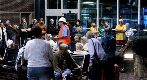 "<div class=""meta ""><span class=""caption-text "">Stranded Amtrak passengers gather after two trains collided in an Oakland, Calif., station on Thursday, Oct. 13, 2011. A fire official said one train was unloading passengers when the second train ran into it at an estimated speed of 15 to 20 miles per hour injuring about 16 people. (AP Photo/Noah Berger) (AP Photo/ Noah Berger)</span></div>"