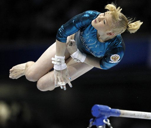 "<div class=""meta ""><span class=""caption-text "">Russia's Tatiana Nabieva competes on her way to winning the silver medal during the final of the women's uneven bars  at  the Artistic Gymnastics World Championships in Tokyo, Japan, Saturday, Oct. 15, 2011. (AP Photo/Koji Sasahara) (AP Photo/ Koji Sasahara)</span></div>"