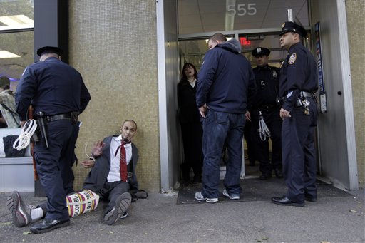 "<div class=""meta image-caption""><div class=""origin-logo origin-image ""><span></span></div><span class=""caption-text"">New York City police officers arrest people who were at a Citibank branch near Washington Square park where the Occupy Wall Street demonstrators are holding a rally, Saturday, Oct. 15, 2011 in New York. (AP Photo/Mary Altaffer) (AP Photo/ Mary Altaffer)</span></div>"