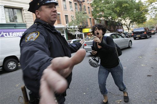 A demonstrator affiliated with the Occupy Wall Street protests shouts at a New York City police officers as people who were at a Citibank branch near Washington Square park were arrested, Saturday, Oct. 15, 2011 in New York. &#40;AP Photo&#47;Mary Altaffer&#41; <span class=meta>(AP Photo&#47; Mary Altaffer)</span>