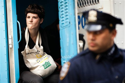 An Occupy Wall Street protester is arrested for allegedly trespassing on Citibank property near Washington Square Park the day after successfully resisting a potential eviction from their camp in Zuccotti Park, Saturday, Oct. 15, 2011, in New York. As many as 1,000 protesters were marching Saturday morning to a Chase bank branch in the financial district, banging drums, blowing horns and carrying signs decrying corporate greed. Other demonstrations are planned around the city all day Saturday. &#40;AP Photo&#47;John Minchillo&#41; <span class=meta>(AP Photo&#47; John Minchillo)</span>