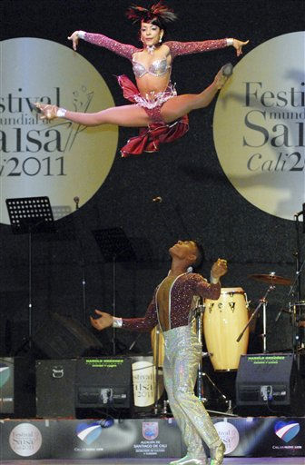 Dancers Fernando Hernandez, bottom, and Marcela Orozco, both from Colombia, perform during the 6th World Salsa Festival in Cali, Colombia, Sunday, Oct. 16, 2011. &#40;AP Photo&#47;Carlos Julio Martinez&#41; <span class=meta>(AP Photo&#47; Carlos Julio Martinez)</span>