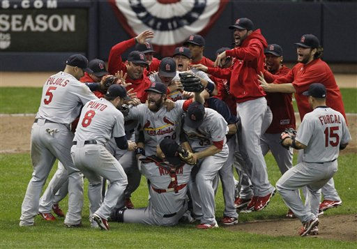 The St. Louis Cardinals celebrate after Game 6 of baseball&#39;s National League championship series against the Milwaukee Brewers Sunday, Oct. 16, 2011, in Milwaukee. The Cardinals won 12-6 to win the series and advance to the World Series. AP Photo&#47;Jeff Roberson&#41; <span class=meta>(AP Photo&#47; Jeff Roberson)</span>