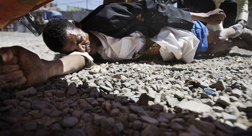 "<div class=""meta image-caption""><div class=""origin-logo origin-image ""><span></span></div><span class=""caption-text"">A wounded protestor lies on the ground after clashes with security forces in Sanaa, Yemen, Tuesday, Oct. 18, 2011. Fighting between troops loyal to Yemen's embattled leader and rival forces on Monday killed several people, including eight supporters of a powerful tribal chief who defected to the opposition in March. (AP Photo/Hani Mohammed) (AP Photo/ Hani Mohammed)</span></div>"