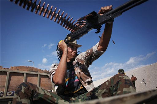"<div class=""meta ""><span class=""caption-text "">A revolutionary fighter fires at Gadhafi loyalists in downtown Sirte, Libya, Tuesday, Oct. 18, 2011. About 1,000 Libyan revolutionary troops have launched a major assault on Moammar Gadhafi's hometown, surging from the east to try to capture the last area under loyalist control. (AP Photo/Manu Brabo) (AP Photo/ Manu Brabo)</span></div>"