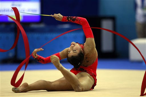 Ana Carrasco Pini, of Argentina, competes in the rhythmic gymnastics individual ribbon final competition during the 2011 Pan American Games in Guadalajara, Mexico, Tuesday, Oct. 18, 2011.&#40;AP Photo&#47;Dario Lopez-Mills&#41; <span class=meta>(AP Photo&#47; Dario Lopez-Mills)</span>