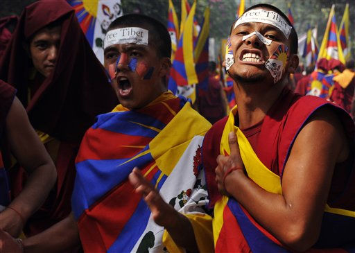 Tibetan exiles shout slogans as they participate in a rally to express solidarity with the plight of the people in Tibet, in New Delhi, India, Thursday, Oct. 20, 2011. Exile Tibetans continued protest after nine Tibetans set themselves on fire in apparent protest against China&#39;s tight grip over Buddhist practices in Tibet. &#40;AP Photo&#47;Tsering Topgyal&#41; <span class=meta>(AP Photo&#47; Tsering Topgyal)</span>