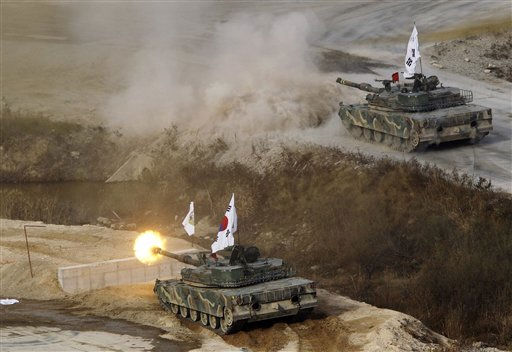 A South Korean army K1A1 tank fires during a live-fire exercise as part of the Seoul International Aerospace and Defense Exhibition at the military drill field near the demilitarized zone in Pocheon, South Korea, Thursday, Oct. 20, 2011. &#40;AP Photo&#47;Ahn Young-joon&#41; <span class=meta>(AP Photo&#47; Ahn Young-joon)</span>