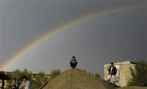 A rainbow appears in the sky, as Afghan men stand on a roadside in Kabul, Afghanistan, Friday, Oct. 21, 2011. &#40;AP Photo&#47;Muhammed Muheisen&#41; <span class=meta>(AP Photo&#47; Muhammed Muheisen)</span>