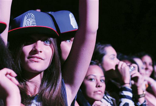 Paris Jackson, at left, watches Chris Brown perform live as part of the F.A.M.E Tour at The Staples Center, Thursday, Oct. 20, 2011, in Los Angeles. The F.A.M.E. Tour began Sept. 12 in Toronto, and will end Oct. 30 in Hartford, Connecticut. (AP Photo/Katy Winn)