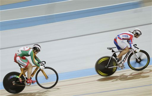 Olga Panarina of Belarus, left, and Viktoria Baranova of Russia, right, compete during the semi finals of the women 200 meters time trial at the European Championships Track Cycling in Apeldoorn, eastern Netherlands, Saturday Oct. 22, 2011. &#40;AP Photo&#47;Peter Dejong&#41; <span class=meta>(AP Photo&#47; PETER DEJONG)</span>
