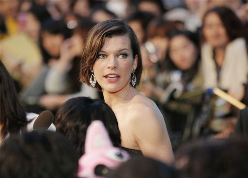 Actress Milla Jovovich arrives at the green carpet for the premiere of &#34;The Three Musketeers&#34; at the Tokyo International Film Festival in Tokyo Saturday, Oct. 22, 2011. &#40;AP Photo&#47;Itsuo Inouye&#41; <span class=meta>(AP Photo&#47; Itsuo Inouye)</span>