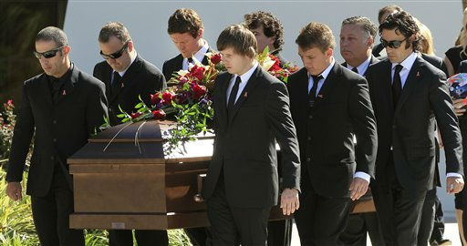 IndyCar drivers Tony Kanaan, left, of Brazil, Scott Dixon, of New Zealand, third from left, and Dario Franchitti,  of Scotland, right, carry the coffin of fellow driver Dan Wheldon after funeral services Saturday, Oct 22, 2011, in St. Petersburg, Fla.  Wheldon was killed Sunday, Oct. 16, 2011, in a fiery 15-car crash at the Las Vegas Motor Speedway. &#40;AP Photo&#47;Chris O&#39;Meara&#41; <span class=meta>(AP Photo&#47; Chris O&#39;Meara)</span>
