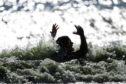 Sebsatian Harmsen of Peru reacts after taking a fall in the men&#39;s wakeboard final during the water skiing event at the Pan American Games in Chapala, on the outskirts of Guadalajara, Mexico, Saturday Oct. 22, 2011. &#40;AP Photo&#47;Dario Lopez-Mills&#41; <span class=meta>(AP Photo&#47; Dario Lopez-Mills)</span>