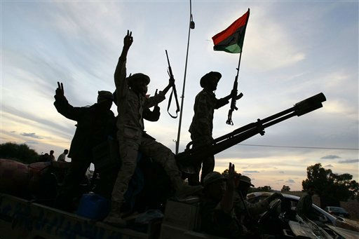 "<div class=""meta ""><span class=""caption-text "">Libyan revolutionary fighters coming back from Sirte are welcomed at Al Guwarsha gate in Benghazi, Libya, Saturday Oct. 22, 2011. Libya's new leaders will declare liberation on Sunday, officials said, a move that will start the clock for elections after months of bloodshed that culminated in the death of longtime dictator Moammar Gadhafi. (AP Photo/Francois Mori) (AP Photo/ Francois Mori)</span></div>"