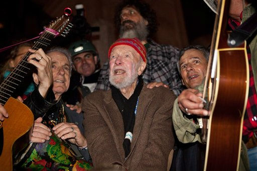 Activist musician Pete Seeger, 92, center, sings before a crowd of nearly a thousand demonstrators sympathetic to the Occupy Wall Street protests at a brief acoustic concert in Columbus Circle, Saturday, Oct. 22, 2011, in New York. The demonstrators marched down Broadway singing &#34;This Little Light of Mine&#34; and other folk and gospel songs while ad-libbing lines about corporate greed and social justice. &#40;AP Photo&#47;John Minchillo&#41; <span class=meta>(AP Photo&#47; John Minchillo)</span>