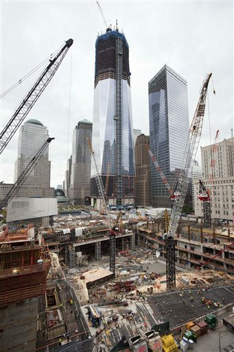 "<div class=""meta ""><span class=""caption-text "">Cranes, center, work on the foundation for the transportation hub at the World Trade Center, Friday, Oct. 21, 2011, in New York. One World Trade Center rises above the construction site. (AP Photo/Mark Lennihan) (AP Photo/ Mark Lennihan)</span></div>"