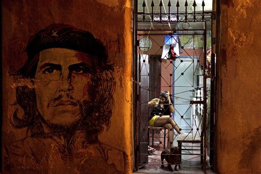 A wall mural of Cuba&#39;s revolutionary leader Ernesto &#34;Che&#34; Guevara adorns the front of a woman&#39;s home in Havana, Cuba, Monday Oct. 24, 2011. The U.N. General Assembly voted overwhelmingly Tuesday for the twentieth time to condemn U.S. sanctions against Cuba. The final vote by U.N. member states was 186 in favor of ending the sanctions, with two countries - the United States and Israel - in favor of keeping them. &#40;AP Photo&#47;Franklin Reyes&#41; &#40;AP Photo&#47;Franklin Reyes&#41; <span class=meta>(AP Photo&#47; Franklin Reyes)</span>