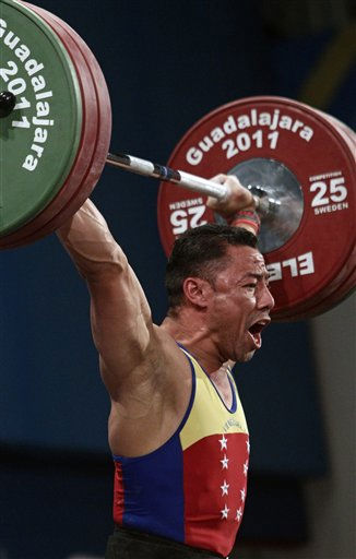 "<div class=""meta ""><span class=""caption-text "">Venezuela's Israel Rubio lifts 145 kg in the snatch of the men's 69 kg weightlifting competition at the Pan American Games in Guadalajara, Mexico, Monday, Oct. 24, 2011.  (AP Photo/Arnulfo Franco) (AP Photo/ Arnulfo Franco)</span></div>"
