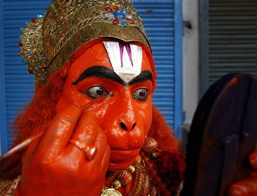 A Indian man dresses up as a monkey god Hanuman to participate in a procession as part of Hindu festival of the Hanuman Jayanti in Allahabad, India, Tuesday, Oct. 25, 2011. Hanuman Jayanti commemorates the birth of Hanuman. &#40;AP Photo&#47;Rajesh Kumar Singh&#41; <span class=meta>(AP Photo&#47; Rajesh Kumar Singh)</span>