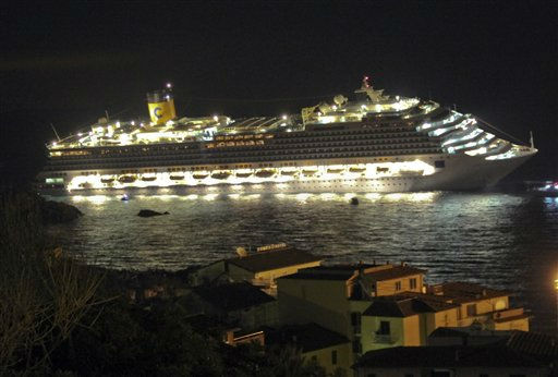 RETRANSMISSION TO IMPROVE QUALITY - The luxury cruise ship Costa Concordia lays on its side after it ran aground off the coast of the Isola del Giglio island, Italy, gashing open the hull and forcing some 4,200 people aboard to evacuate aboard lifeboats to the nearby Isola del Giglio island, early Saturday, Jan. 14, 2012. About 1,000 Italian passengers were onboard, as well as more than 500 Germans, about 160 French and about 1,000 crew members. &#40;AP Photo&#47;Giorgio Fanciulli, Giglionews.it&#41; <span class=meta>(AP Photo&#47; Giorgio Fanciulli)</span>