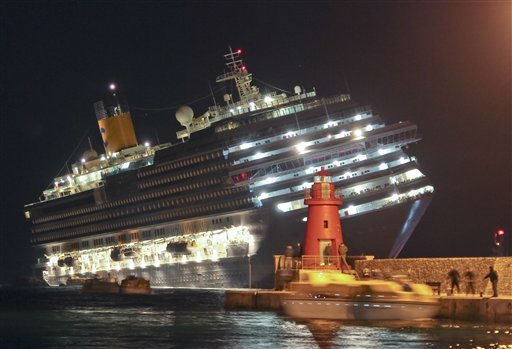 RETRANSMISSION TO IMPROVE QUALITY - Rescuers surround the luxury cruise ship Costa Concordia after it ran aground off the coast of Isola del Giglio island, Italy, gashing open the hull and forcing some 4,200 people aboard to evacuate aboard lifeboats to the nearby Isola del Giglio island, early Saturday, Jan. 14, 2012. About 1,000 Italian passengers were onboard, as well as more than 500 Germans, about 160 French and about 1,000 crew members. &#40;AP Photo&#47;Giorgio Fanciulli, Giglionews.it&#41; <span class=meta>(AP Photo&#47; Giorgio Fanciulli)</span>
