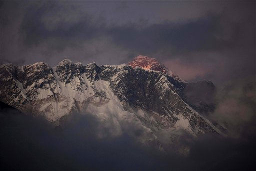 The last light of the day sets on Mount Everest as it rises behind Mount Nuptse as seen from Tengboche, in the Himalaya&#39;s Khumbu region, Nepal, Thursday, Oct. 27, 2011. Everest, the world&#39;s highest mountains, stands at 8,848 meters &#40;29,029 feet&#41;. &#40;AP Photo&#47;Kevin Frayer&#41; <span class=meta>(AP Photo&#47; Kevin Frayer)</span>