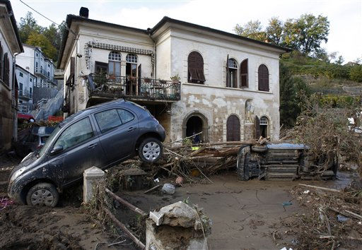 Car wrecks are covered with mud in Borghetto Di Vara, in the Italian north-western region of Liguria, Thursday, Oct. 27, 2011, following violent rains and floods that struck in the area. Soldiers and civilian rescue workers battled knee-deep mud Thursday as they searched for survivors after flash floods and mudslides inundated picturesque villages around coastal areas of Liguria and Tuscany. &#40;Ap Photo&#47;in Borghetto Di Vara, Italy, Thursday, Oct. 27, 2011. &#40;AP Photo&#47;Antonio Calanni&#41; <span class=meta>(AP Photo&#47; Antonio Calanni)</span>