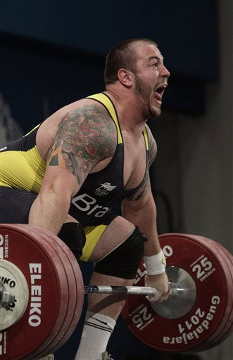 Brazil&#39;s Fernando Reis lifts 185 kg in the snatch of the men&#39;s &#43;105 kg weightlifting competition of the Pan American Games in Guadalajara, Mexico, Thursday, Oct. 27, 2011. Reis set a new Pan American record.  &#40;AP Photo&#47;Arnulfo Franco&#41; <span class=meta>(AP Photo&#47; Arnulfo Franco)</span>