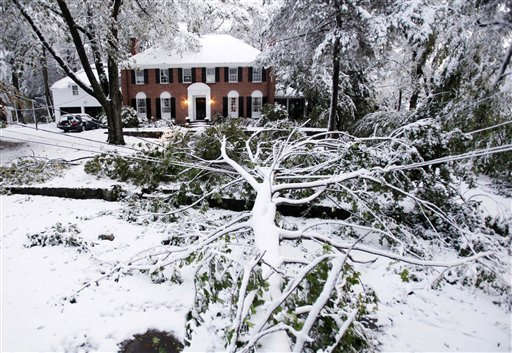 "<div class=""meta ""><span class=""caption-text "">A downed tree limb lies across power lines in Belmont, Mass., Sunday, Oct. 30, 2011.  A snowstorm with a ferocity more familiar in February than October  socked the Northeast over the weekend, knocking out power to 2.3 million, snarling air and highway travel and dumping more than 2 feet of snow in a few spots as it slowly moved north out of New England. (AP Photo/Michael Dwyer) (AP Photo/ Michael Dwyer)</span></div>"